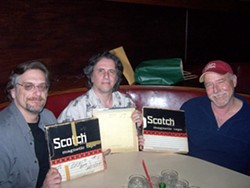 COLLABORATORS :  (Left to right) Brother Records, Inc. Beach Boys archivist Alan Boyd, Brian Wilson producer Mark Linett, and local singer-songwriter Lance Robison hold the three tapes Capitol and Brother Records used to release new stereo re-masters of two classic Beach Boys tracks on Summer Love Songs. - PHOTO COURTESY OF LANCE ROBISON