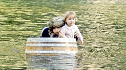 JUST AROUND THE RIVER BEND:  In the midst of their adventure, JoJo and Avila find themselves riding down the river in a barrel, while being chased by an errant hobo. - PHOTO COURTESY OF BRIAN SCHMIDT AND ANN-MARIE PLASTINO
