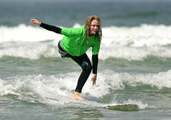 STOKED :  Julie Carruthers, the volunteer coordinator of fundraising for AmpSurf, will ride at the event. - PHOTO COURTESY OF AMPSURF