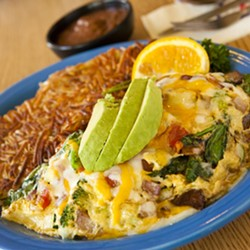 RISE AND SHINE :  The vegetarian omelet at Zorro's is filled with fresh spinach, tomatoes, broccoli, onions, bell pepper, and cheese—plus, it comes with crispy hash browns - PHOTO BY STEVE E. MILLER