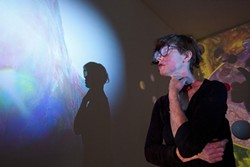 """ARTY EARTH BABE :  At the University Art Gallery, Oakland artist Suzy Poling's exhibit """"Into the Center of the Earth"""" explored what our planet's core might look like through the use of video projection, photography, and installation. - PHOTO BY STEVE E. MILLER"""