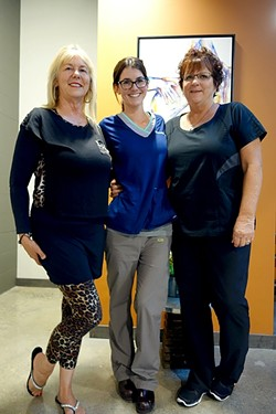 THE LADIES OF OPEN CANVAS :  (Left to right) Mom Kathy Cohen, Open Canvas Laser co-owner and daughter Emerald McLeod, and employee Maggie St. Vincent greeted wandering art lovers last Friday. - PHOTO BY GLEN STARKEY