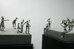 DON'T JUMP! :  This sculptural diptych features gestural little people playing out a scene divided by a chasm. - PHOTOS BY GLEN STARKEY