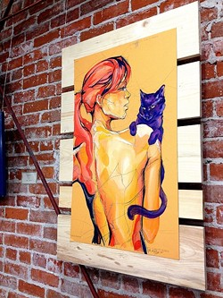 CAT LADY:  Sara LeGrady's vibrant paintings adorned the walls of Tigerlily Salon as part of SLO's Art After Dark. - PHOTO BY JESSICA PEÑA