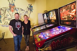 BE EXCELENT, EAT EXCELLENT:  Mike and Becky Hicks encourage loitering at their neighborhood hangout, Lincoln Market. Drink a beer, grub down, or try your hand at some vintage pinball. - PHOTO BY KAORI FUNAHASHI