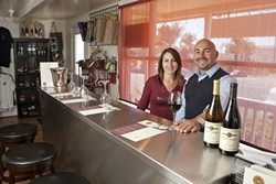 SEEING RED :  David Addamo opened Red Carpet Winery in Pismo Beach this year, and his daughter Nicole manages the tasting room. The space, including the huge patio, is available for parties—and the Addamos certainly know how to celebrate. - PHOTOS BY STEVE E. MILLER