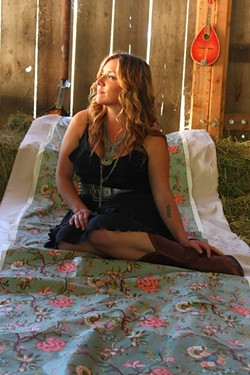 SHE'S THE ONE:  Natalie Haskins (pictured) joins fellow singer-songwriters Joe Koenig and Jon Clarke at Broken Earth Winery on March 28. - PHOTO BY MARISSA KNUCKLES