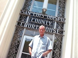 Lawrence Bass stands outside the SLO County courthouse, where he has filed restraining orders against a sheriff's deputy and a judge. - PHOTO BY COLIN RIGLEY