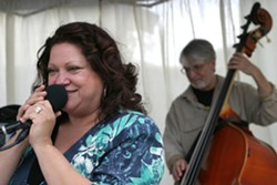 """SING IT, SISTER :  Diane Steinberg, Kenny Lee Lewis' wife, belts out an awesome rendition of ZZ Top's """"Sharp Dressed Man"""" while bass master Ken Hustad keeps time. - PHOTO BY GLEN STARKEY"""