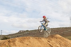 GETTING AIR:  Ten-year-old Annabella Finley launches off one of the jumps at the new Morro Bay Bike Park during its grand opening day Dec. 26. The park is located at Main Street and Radcliff Avenue, right off Highway 1. It's open to the public free of charge. - PHOTO COURTESY OF KATIE FINLEY