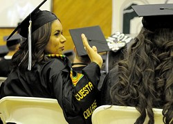 DO THE WAVE:  Students at Cuesta's 49th annual commencement ceremony interacted with each other and their friends and family members who came to support them from the audience. - PHOTO COURTESY OF JAY THOMPSON