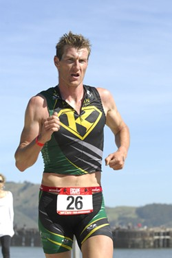 RUNNING STRONG :  Chris Stehula is a swimmer, a cyclist, and a runner. His first place finish in a national collegiate triathlon qualifies him for an upcoming world championship in Spain. - PHOTO COURTESY CHRIS STEHULA