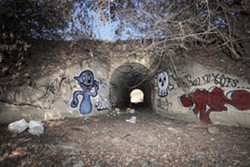 A CONCRETE GALLERY :  Tunnels found along SLO's railroad corridor provide graffiti artists a canvas. - PHOTO BY STEVE E. MILLER
