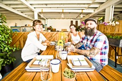 HUCKLEBERRY WIN:  Carla Wingett and Karen Irwin, the owners of Huckleberry Market, are teaming up with local painter Neal Breton to bring an artistic spark to their store. - PHOTO BY HENRY BRUINGTON