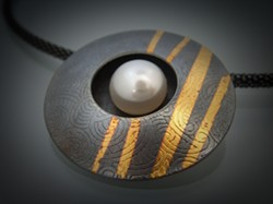 """I'LL FOLLOW THE SUN:  Ina Hohensee's """"wearable art"""" jewelry, including her Sun Pendant (pictured), weds contemporary forms with elements from nature. - PHOTO COURTESY OF STUDIOS ON THE PARK"""