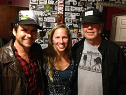 THANK YOU, GOOD MEDICINE PRESENTS!:  Willie Nelson's son Lukas Nelson (left), Good Medicine Presents co-owner Korie Newman (center), and iconic rocker Neil Young (right) joined forces to play a last minute, secret concert at SLO Brew. - PHOTO BY GLEN STARKEY