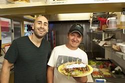 HERO OF THE GYROS :  Samir Aburashed and Chef Antonio Ruiz show off their gyro sandwich. - PHOTO BY STEVE E. MILLER