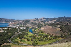 THE AVILA TRIAD:  As seen from Ontario Ridge, Avila Point (far left), the Avila Beach Golf Resort (center), and Wild Cherry Canyon (background) surround the tiny community of Avila Beach. The ultimate fate of development plans at all three sites could significantly impact the future of Avila. - PHOTO BY KAORI FUNAHASHI