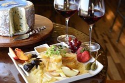 FRESH AND LOCAL :  The Bella Vino signature cheese plate is made up of all locally made cheese and fresh produce. - PHOTO BY STEVE E. MILLER
