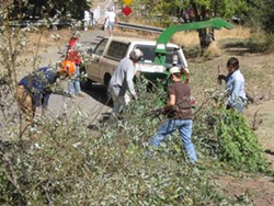 WORKING UP A SWEAT :  Patterson volunteers every year to help clean Yerba Buena Creek and prevent it from flooding Santa Margarita during heavy winter storms. - PHOTO COURTESY OF HEIDI PETERSEN