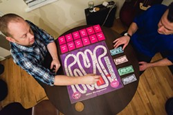 PLAYERS!:  SLO Towners Forrestt Williams and Jason Main, the creators of A$$et Management, a Monopoly-like game with pimps trying to control the most hoes, will launch a crowd funding campaign in the - next few months. - PHOTO BY KAORI FUNAHASHI