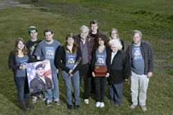 FAMILY AND FRIENDS :  U.S. Army Specialist John Fish lives in the memories of, from left to right, stepsister Amanda Edick, buddy Lance Wilkerson, stepbrother Brian Edick, sister Sarah Masters, grandfather Gene Griffin, friend Matt Ingerwerson, mother Cathy Fish (holding box), friend Ashley Sobczak, grandmother Evie Arritt, and stepbrother Tom Edick. - PHOTO BY STEVE E. MILLER