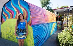 THE COLOR OF CONTROVERSY:  Pamela Dailey stands in front of her painted garage at the Santa Margarita Mobile Home Park. Park management told Dailey that she needs to repaint it or face eviction. - PHOTO BY KAORI FUNAHASHI