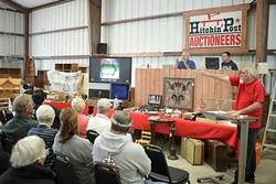 FAST MONEY :  The Erpenbachs have seen a dramatic recent increase in items offered for sale in their family-run auction business. - PHOTO BY STEVE E. MILLER