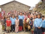 PEACE THROUGH EDUCATION :  Santa Margarita college student Danny Chaffin (kneeling) spearheaded a school-building project for boys and girls in a remote village in the mountains of Nepal. - PHOTO COURTESY OF JAN SPRAGUE-CHAFFIN
