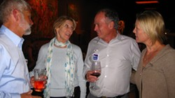 COWORKER'S LAST HOORAY :  Supervisor Bruce Gibson stopped by the wine bar to back fellow board member Jim Patterson and schmooze with his supporters. With only a few precincts reporting at this point, moods were still optimistic. - PHOTO BY NICK POWELL