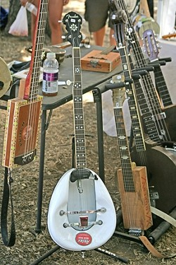 BEDPAN BANJO! :  A luthier displayed a vast collection of his unusual one-of-a-kind stringed instruments in the vendors' area.