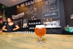 SWEET N SOUR:  Libertine Pub's new 9,000-square-foot brewing facility is home to a cozy-yet-edgy tasting room at 1234 Broad St. in Downtown SLO. Founder and head of brewing operations Tyler Clark aims to transform the space into a place for wild sour beers as well as cold brew coffee, food, and local artisanal goods. - PHOTO BY KAORI FUNAHASHI