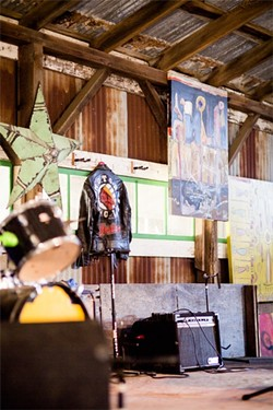 RARE STYLE:  This leather jacket was given to SLO Tracks founder and local musician Vincent Bernardy during his days as a Minneapolis area booker in the late '80s and early '90s. Only a handful were made, two of which went to Madonna and one to Prince. The rock-n-roll relic now hangs alongside local artwork at the Edna Valley barn-turned-venue, which aims to provide a thoughtfully-curated lineup of all-ages shows in 2014. - PHOTO BY HENRY BRUINGTON