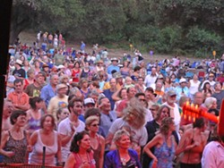 BE A PART OF THE COMMUNITY :  Upwards of 5,000 people attend Live Oak Music Festival, creating a little city in a dusty campground off Hwy. 154. - PHOTO BY GARY ROBERTSHAW