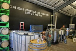 BOOZE TOWN :  With the demand for craft spirits continuing to grow in the county, Wine Shine is currently working on getting a bigger still so they can increase production of their spirits. - PHOTO BY DYLAN HONEA-BAUMANN