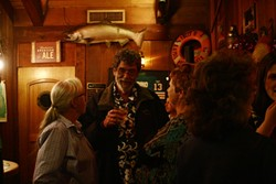 TAKING IT IN STRIDE :  Morro Bay Mayor Bill Yates kept the mood light as supporters clinked cocktail glasses and exchanged concerns for the city's future at Councilman George Leage's Great American Fish Company. - PHOTO BY MATT FOUNTAIN