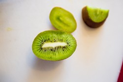 JUST ONE MORE:  Grown on Mallard Lake Ranch in west Nipomo, Bob Criswell's kiwifruit is sweet, tangy, juicy, and totally addictive. - PHOTO BY KAORI FUNAHASHI
