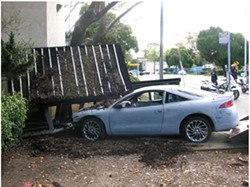 NOT A SCHEDULED STOP :  This vehicle slipped from its restraints on a flat-bed truck and careened into a bus stop, causing roughly $5,000 in damages. - PHOTO COURTESY OF SAN LUIS OBISPO POLICE DEPARTMENT