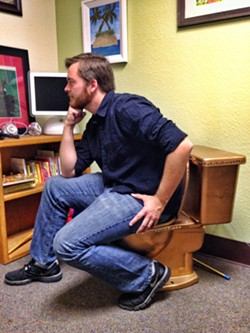 DEEP THUNKER:  This is Nick Powell, sitting on the office toilet. He wanted to write something about a poop joke here. - PHOTO BY STEVE E. MILLER