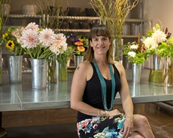 EVERYONE LOVES FLOWERS:  Clover and Branch owner Carrie Skelton plays host to a flower fest every Friday in her floral studio, with fresh flower arrangements that'll look great anywhere you put them. - PHOTO BY STEVE E. MILLER