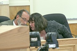 IN HOT WATER :  Embattled Cambria Community Services District General Manager Tammy Rudock (pictured, right) conferred with Assistant District Counsel David Hirsch after being berated by angry residents at an April 28 board meeting. - PHOTO BY MATT FOUNTAIN