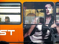 "RIDE ALONG:  Dwyer captures the striking image of a girl on a bus in ""Bus Girl."" - PHOTO BY GARY DWYER"
