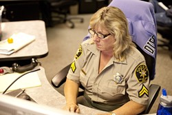 VETERAN :  Senior Dispatcher Kelly Fontes has been on the job for 15 years. - PHOTO BY STEVE E. MILLER