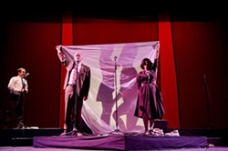 PAY NO ATTENTION TO THE SEX BEHIND THE CURTAIN!:  L.A. Theatre Work's production of The Graduate, adapted as a live radio play, incorporates visual as well as aural tricks to tell the story of Ben Braddock and Mrs. Robinson—played by Brian Tichnell and Heidi Dippold, pictured behind the bed sheet. In a simultaneous scene, Ben's parents—played by Tom Virtue and Diane Adair—hold the sheet aloft, oblivious. Darren Richardson plays the psychiatrist in the left hand corner. - PHOTO BY MATT PETIT