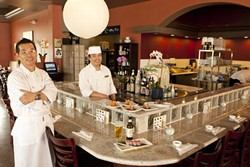 """WRAP AND ROLL:  Restaurateur Bruce Lee and chef """"Cat Fish"""" Kim present culinary delights such as a beef tataki wrap, salmon avocado wrap, tuna tataki wrap, and sashimi salad wrap. - PHOTO BY STEVE E. MILLER"""
