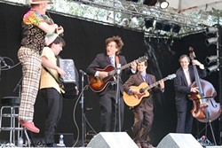 EVERYBODY JUMP!:  Emcee Joe Craven (left) jumps for joy while sitting in with Frank Vignola's Hot Club on the main stage. - PHOTO BY GLEN STARKEY