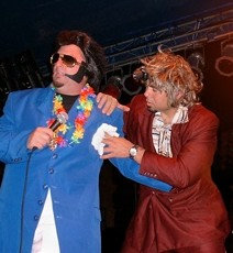 THANK YOU, THANKYOUVERYMUCH! :  Tortelvis gets some flopsweat help from his personal assistant and towel boy Charlie Haj during a live performance of Dread Zeppelin, which performs at Sweet Springs Saloon on Aug. 14 as part of Wet Zeppelin, a five-day concert and wine series. - PHOTO COURTESY OF DREAD ZEPPELIN