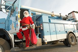 BYE BYE SLEIGH:   Santa escapes the stress of working at the North Pole with a part-time job with PG&E. - PHOTO BY STEVE E. MILLER