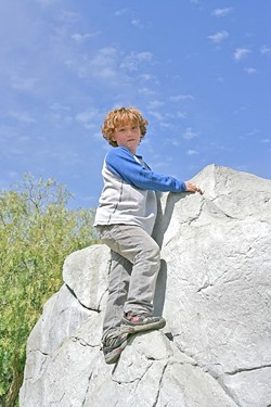 SKY HIGH J:  aden Robertshaw, almost 9 years old, scaled a synthetic rock in the play area. - PHOTO BY GLEN STARKEY