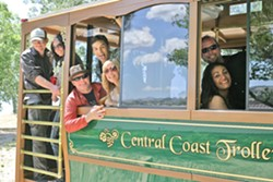 ALL ABOARD! :  (Left to right) David, Tamara (the birthday girl!), Chad, Dan, Rakesha, Chris, and Patty are among the dozens of us who rode the Central Coast Trolley to four Paso Robles wineries. - PHOTO BY GLEN STARKEY